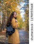pretty young woman walking in... | Shutterstock . vector #1198955668