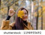 pretty young woman walking in... | Shutterstock . vector #1198955692