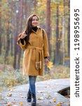 pretty young woman walking in... | Shutterstock . vector #1198955695