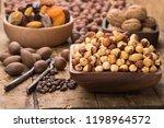 hazelnut peeled roasted in bowl ... | Shutterstock . vector #1198964572