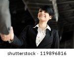 Happy businesswoman handshake - stock photo