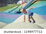 little boy playing on an... | Shutterstock . vector #1198977712