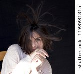 girl with dishevelled hair | Shutterstock . vector #1198981315