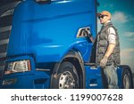 Semi Truck Cargo Transport. Caucasian Driver and the Modern Vehicle. Transportation Industry. - stock photo