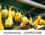 different pumpkins on city... | Shutterstock . vector #1199032588