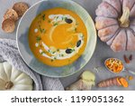 pumpkin creme soup in ceramic... | Shutterstock . vector #1199051362