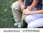 comforting hand. young nurse... | Shutterstock . vector #1199094868