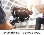 motorized gimbal, videographer using dslr camera anti shake tool  for  stabilizer record video scene. - stock photo