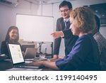 a group of employees are asian...   Shutterstock . vector #1199140495