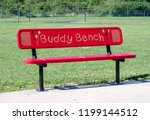 Red Buddy Bench On A School...