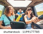 group of people travel by car.... | Shutterstock . vector #1199177785