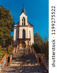 europe village church on a... | Shutterstock . vector #1199275522