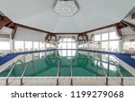 indoor swimming pool in hotel... | Shutterstock . vector #1199279068