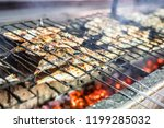 small fish barbequed on charcoal | Shutterstock . vector #1199285032