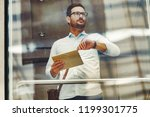 businessman checking watch... | Shutterstock . vector #1199301775