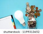 coins in glass jar and outside  ... | Shutterstock . vector #1199313652