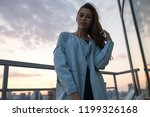 attractive young woman stands... | Shutterstock . vector #1199326168