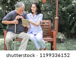 nurse with patient sitting on...   Shutterstock . vector #1199336152