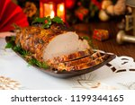 roast pork loin with christmas... | Shutterstock . vector #1199344165