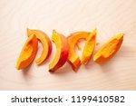 cooking pumpkin. pumpkin pieces.... | Shutterstock . vector #1199410582