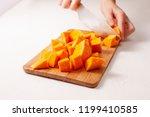 cut into pieces raw pumpkin on... | Shutterstock . vector #1199410585