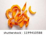 cooking pumpkin. pumpkin pieces.... | Shutterstock . vector #1199410588