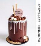 chocolate cake white icing... | Shutterstock . vector #1199412808