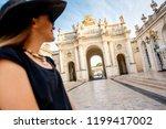 young woman tourist enjoying... | Shutterstock . vector #1199417002