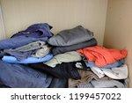 heap of clothes | Shutterstock . vector #1199457022
