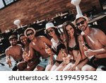young friends with alcoholic... | Shutterstock . vector #1199459542