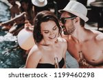 smiling couple with alcoholic... | Shutterstock . vector #1199460298