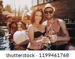 smiling couple with alcoholic... | Shutterstock . vector #1199461768