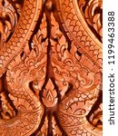 wood carving in thai temple wall | Shutterstock . vector #1199463388