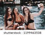 young women in bikini taking... | Shutterstock . vector #1199463538