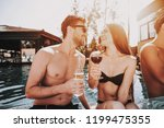 young smiling couple drinking... | Shutterstock . vector #1199475355