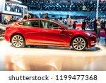 Small photo of Paris, France, October 02, 2018: metallic red Tesla Model 3 at Mondial Paris Motor Show, produced by American automaker Tesla, main shareholder Elon Musk