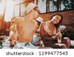 smiling couple with alcoholic... | Shutterstock . vector #1199477545