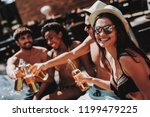 young friends with alcoholic... | Shutterstock . vector #1199479225