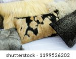 pillows made out of real fur on ... | Shutterstock . vector #1199526202