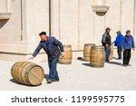 winemakers move barrels with...   Shutterstock . vector #1199595775