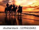 A Silhouette Photo Of Horsemen...