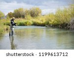 fly fisherman on the ruby river ... | Shutterstock . vector #1199613712