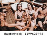 young friends with alcoholic... | Shutterstock . vector #1199629498