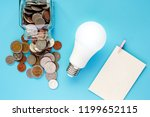coins in glass jar and outside  ... | Shutterstock . vector #1199652115