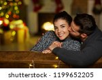 christmas couple at home in... | Shutterstock . vector #1199652205