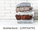 stack of cozy woolen clothes.... | Shutterstock . vector #1199764792