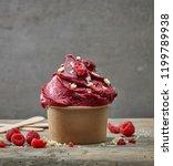 paper cup of raspberry sorbet...   Shutterstock . vector #1199789938