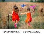 little girls having fun... | Shutterstock . vector #1199808202