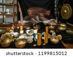 woman playing  a singing bowls... | Shutterstock . vector #1199815012
