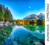 autumn sunset of hintersee lake.... | Shutterstock . vector #1199825662